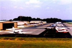 Airport showing airplanes and hangars